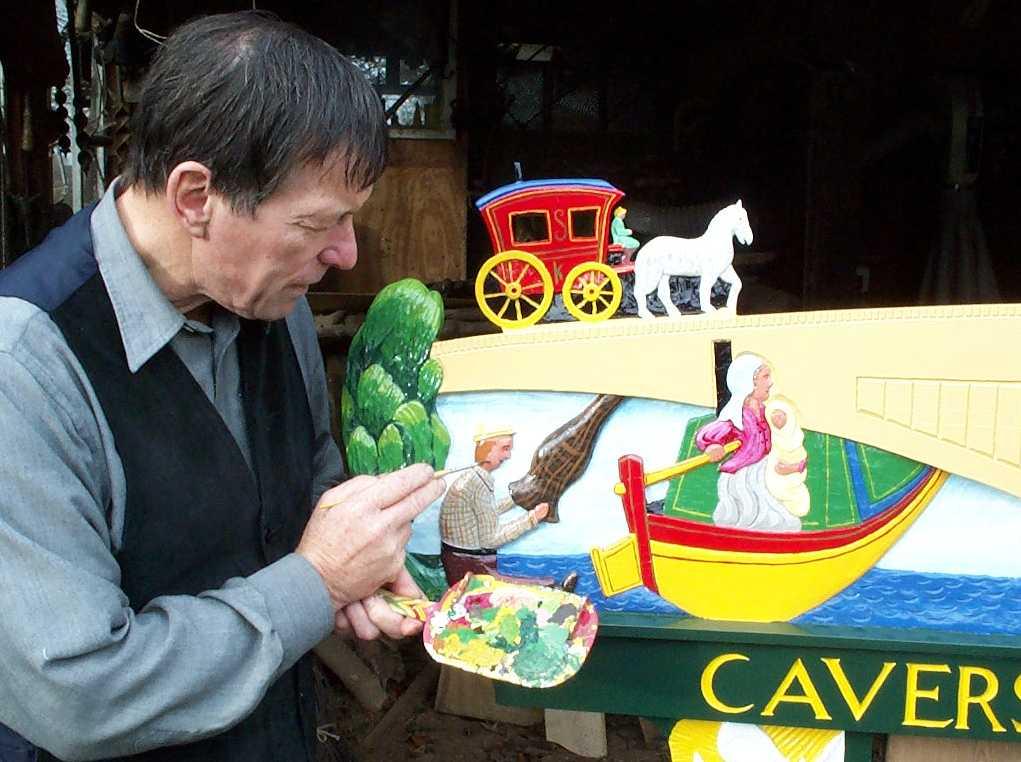 Stuart King with the Caversham sign